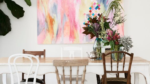 The dining room features a painting by Kachel, her mum and Coco. Photo: Eve Wilson