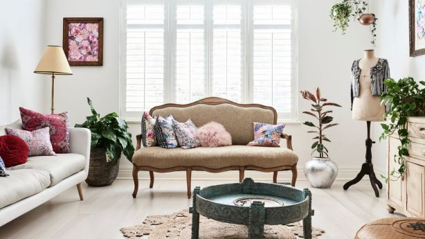 The standout piece in the lounge room is a vintage French settee. Photo: Eve Wilson