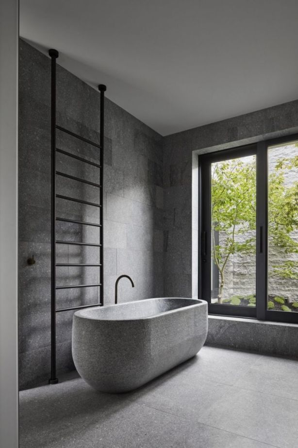 The custom bath and basin overlook a private courtyard with an outdoor shower. Photo: B.E Architecture