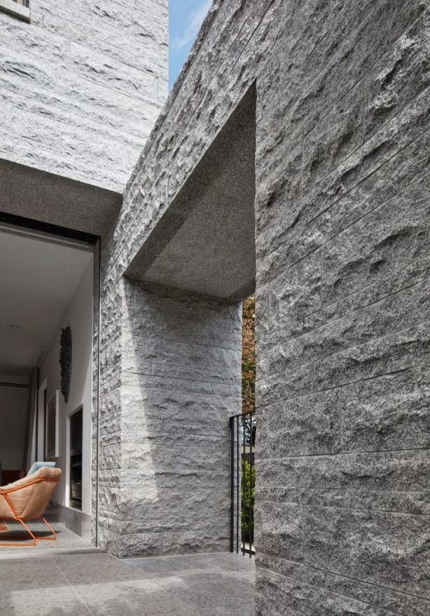 The three-level house is constructed from 260 tonnes of granite. Photo: B.E Architecture