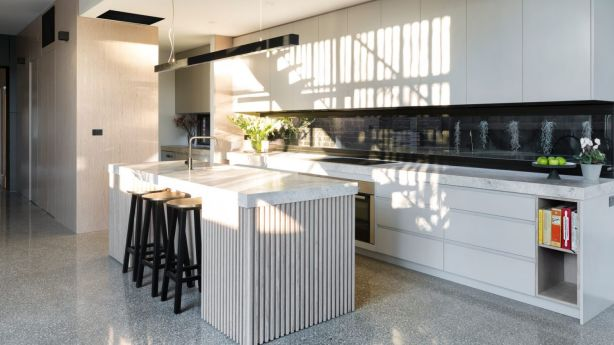 A showpiece of this family home in Northcote is the expansive, naturally lit kitchen, dining and family area. Photo: Jellis Craig
