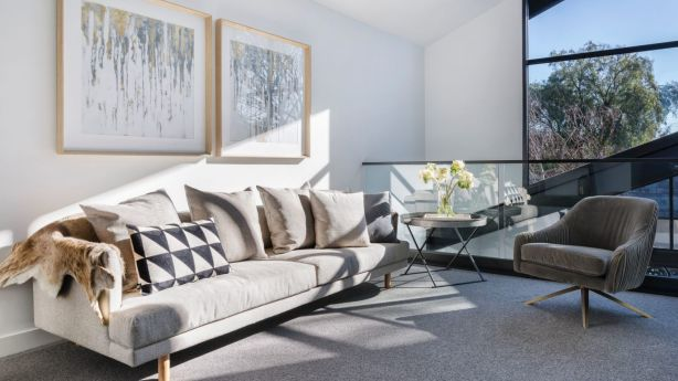 A relaxing lounge area at 71 Cunningham Street, Northcote. Photo: Jellis Craig