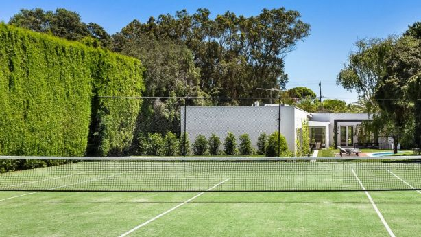 The resort-style home has its own tennis court and an in-ground trampoline. Photo: Supplied