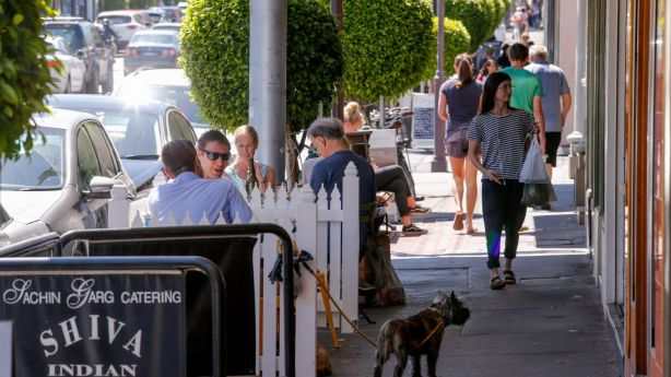Shoppers and cafe patrons enjoy the atmosphere along Malvern Road in Hawksburn Village. Photo: Wayne Taylor