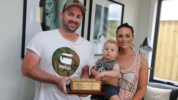 John Cole, pictured with his wife Hannah and one of their children, was the winning bidder of the 'Build for a cure' house.