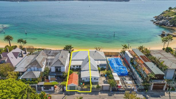 A Watsons Bay semi backing onto Camp Cove sold for $14.2 million under the hammer on Monday. Photo: BradfieldCleary