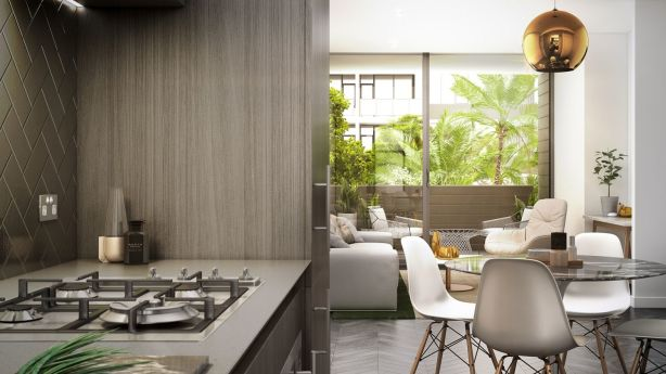 Interiors have an industrial edge with open cabinetry and herringbone splashbacks in the kitchen. Photo: Artist's impression