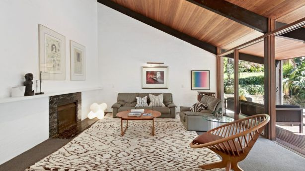 The home is striking with black timber beams, spotted gum ceilings and white-washed walls. Photo: Supplied