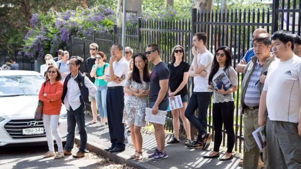 The crowd at the auction of 58 Derwent Lane, Glebe. Photo: Steven Woodburn