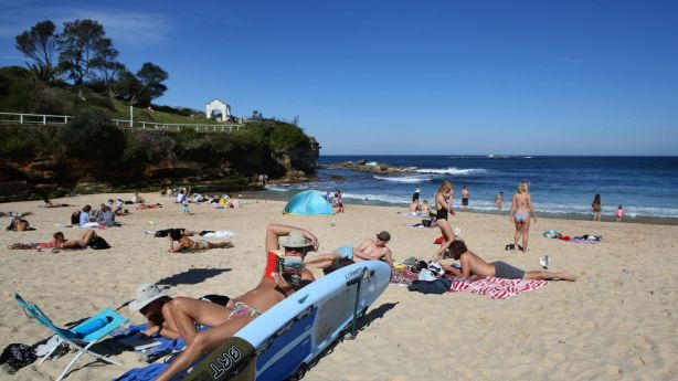 Sunny weather: good for the beach, and good for auction prices, according to a new study. Photo: James Alcock/Fairfax Media
