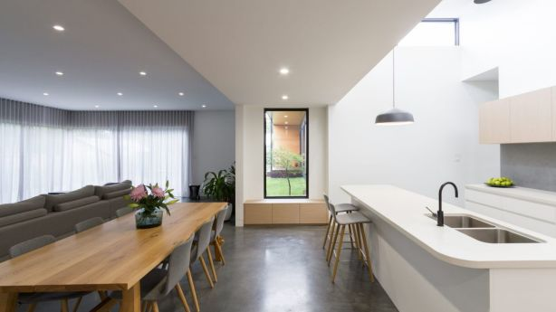 The kitchen and the living room is the central piece of the home and is where the indoor-outdoor connection is most prominent, with the kitchen featuring a pop-up roof element. Photo: LightStudies