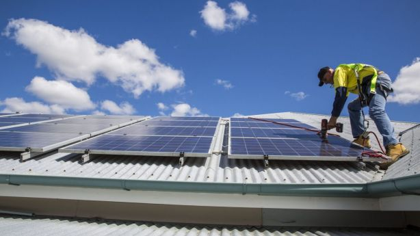 The bar is still too high for many homeowners, with an average solar and battery system costing about $13,000, according to Origin. Photo: Glenn Hunt