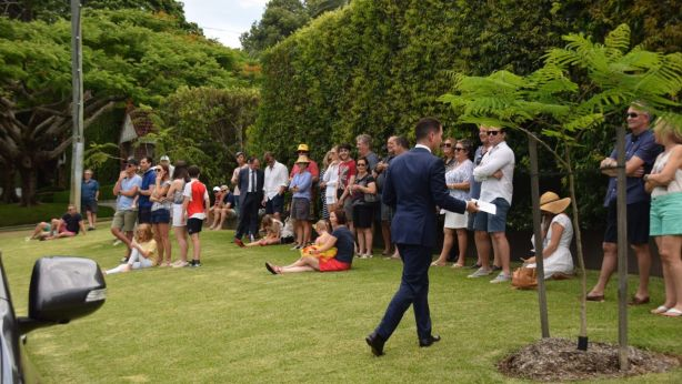 Part of the crowd gathered to watch the 33 Sutherland Avenue auction. Photo: Jim Malo