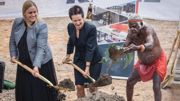 City West Housing chief executive Leonie King (left) and Lord Mayor Clover Moore at the sod-turning ceremony for the development, as Uncle Max Eulo performs a smoking ceremony. Photo: Shane Jones Photography