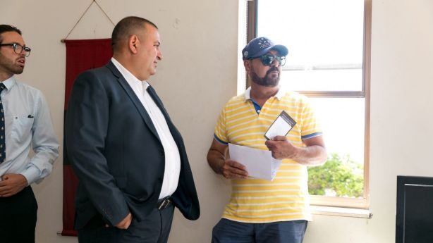 Selling agent Martin Farah speaks with the bidder that made the final offer of $1.28 million. Photo: Steven Woodburn