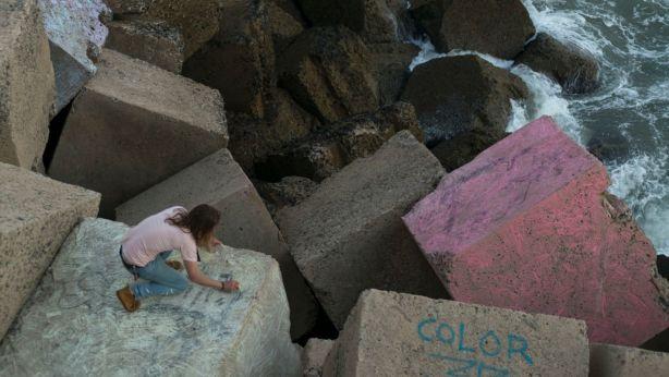 David Brophy working on <i>Rocas del Arco Iris</I> sea wall mural in Cadiz. Photo: Alessandro Bianchetti