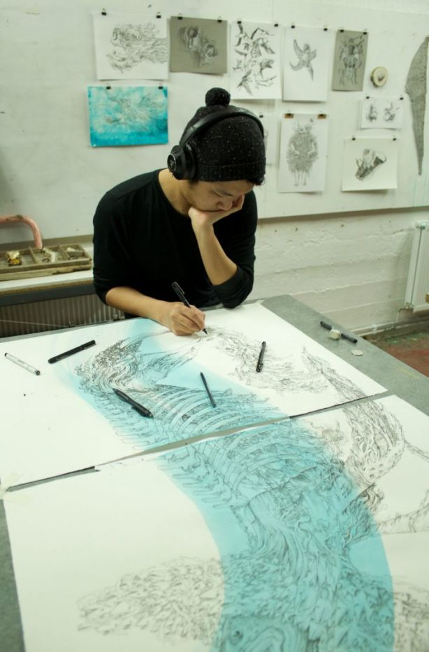 Brian Cheung, seen working in Iceland, says residencies  helped him gain confidence his work.