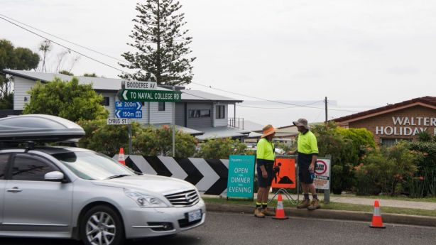 Traffic controllers, parking rangers and council workers are stationed throughout the village to help manage congestion. Photo: Louise Kennerley