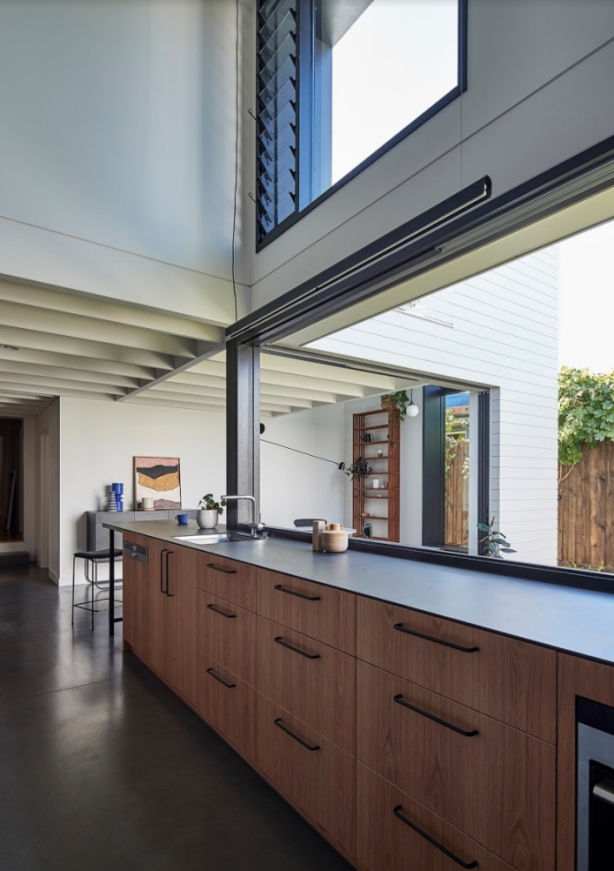 A stretched linear kitchen bench and home office joined the dining space to the living room, emphasising length and size. Photo: Peter Bennetts