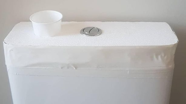 The porcelain lid of Scott Tait's cistern has been replaced with polystyrene into which a bottomless plastic cup has been inserted. This allows him to easily fill up the cistern with rain water for flushing. Photo: Supplied