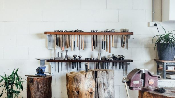The silversmith has an extensive hammer collection. Photo: Andy Mullins