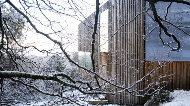 The timber-battened building is so apt in its use of a local tree species, celery-top pine; in how it snugs into the slope of a sometimes snowed-in setting. Photo: Megan Baynes