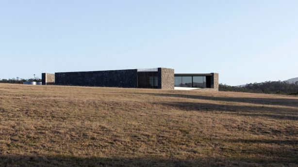 The robust and hunkered-down three-bedroom house on Bruny Island designed by Bailey and Baynes. Photo: Ben Hosking