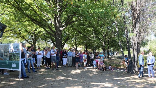 A large crowd gathered to watch the auction on the unseasonably warm April day in Canberra. Photo: Lucy Bladen