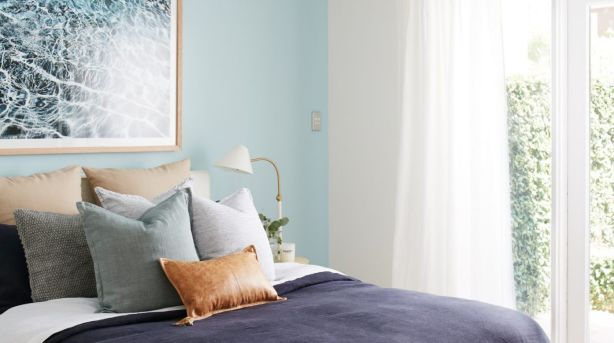 """Cultiver Goods bed linen and pillows, like the brown """"Yoko"""" leather lumbar cushion, are a great way to introduce colours to your scheme. Other products featured include """"We are electric"""" photographic print in oak frame by Danielle Cross, Nordic dresser and Victoria slip cover bedhead from Globe West and the Lily side tables Life Interiors. Photo: Lynden Foss"""