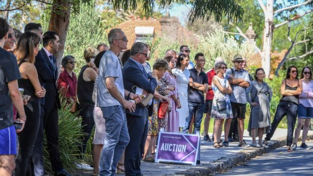 More than 50 people lined the street for the auction of the Lilyfield home. Photo: Peter Rae
