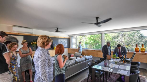 Potential buyers inspect the property before auction. Photo: Peter Rae