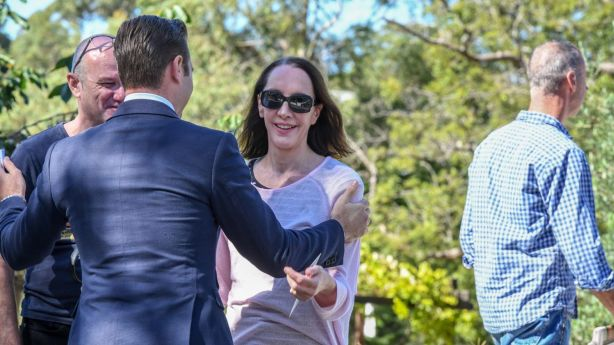 Selling agent David Eastway of Hudson McHugh congratulates the buyers after the auction. Photo: Peter Rae