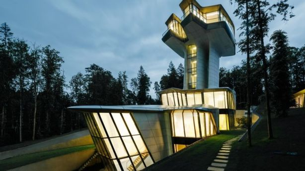 Rising from the forest like a futuristic spaceship, this stunning new house designed by the late Zaha Hadid was built for a wealthy Russian owner. Photo: okogroup.com