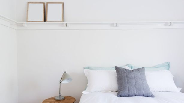 Keep your rooms impersonal by removing photos from frames. Photo: iStock