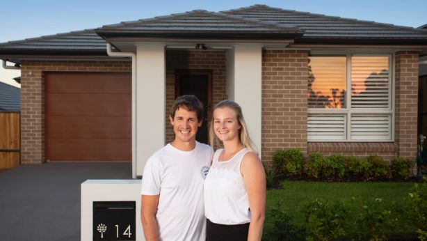 First home buyers, David and Megan Bunston, outside their new Box Hill home. Photo: Quentin Jones