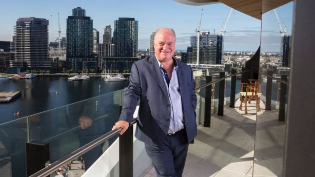 Peter Anderson moved in a two-bed apartment at the Docklands just before Christmas. He says the area has come a long way in the past 20 years. Photo: Stephen McKenzie