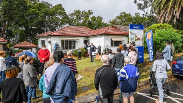 More than 30 people braved the miserable morning for the auction of 10 Maze Avenue, Ryde, on the market for the first time in more than 60 years. Photo: Peter Rae