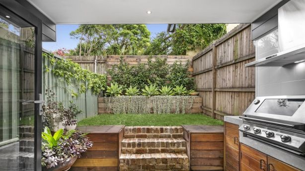 Expansive doors opening to an outdoor entertaining area is a key feature of a successful terrace renovation. Photo: Supplied