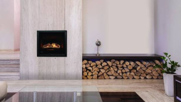 Rinnai's Ember is a compact gas fire that has the option of logs or river stones. Photo: Rinnai