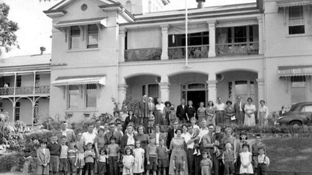 Migrants out the front of the historic Yungaba House, Kangaroo Point, Brisbane.