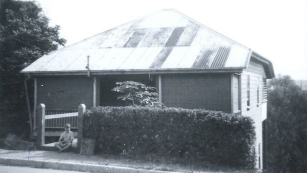 A different Paddington life: Glen Cameron in 1954, sitting outside his Tooth Avenue home. Photo: Supplied