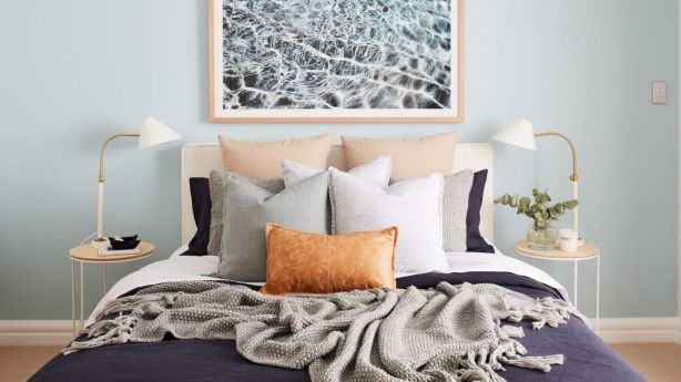 Bed linen and pillows are a great way to introduce coastal colours to your scheme. Photo: Lynden Foss
