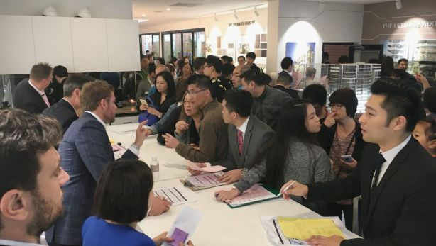 Buyers hustling to secure units at the launch of a new apartment block in Sydney's Epping developed by Chinese developer Greaton back in October 2016. Photo: SUPPLIED/Greaton