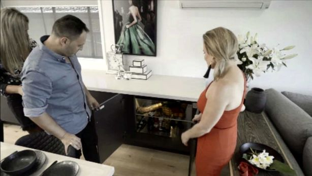 The dumbwaiter made an appearance on Buying Blind, much to the delight of contestants Jess and Fotis and interior design expert Shaynna Blaze. Photo: Channel Nine