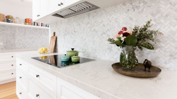 Easily damaged surfaces in the kitchen  not only means more time cleaning, but more worry as well. Photo: Jodie Johnson