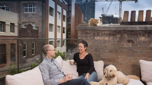 Anthony Rogers and Bernie Mullin, with their cat Toby and dog Bailey, on their Chippendale rooftop oasis. Photo: Quentin Jones