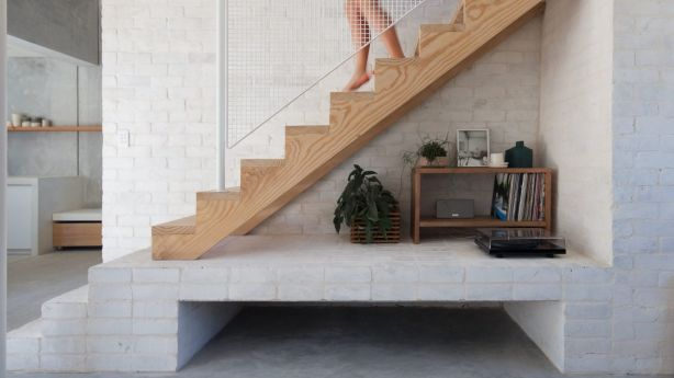 The stairs lead to the only bedroom. Photo: BEN HOSKING