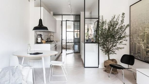 Consider bringing the outdoors in via an oversize plant or tree, such as this unique Stockholm apartment. Photo: Fantastic Frank