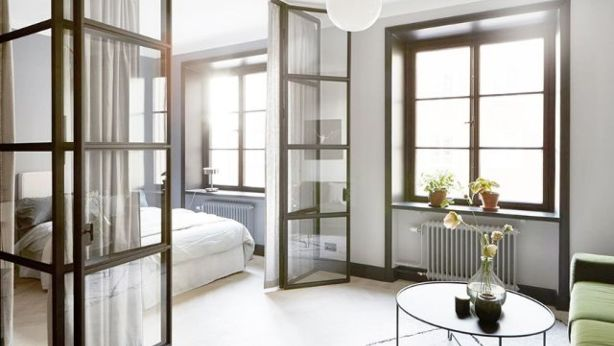 Get creative with dividers and install glass partitions the way this Stockholm home did. Photo: Fantastic Frank