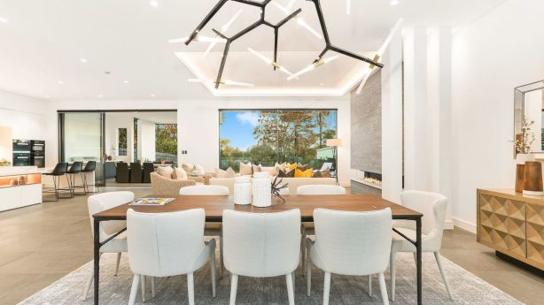 The residence uses commercial-grade concrete and glass across a split-level floor plan. Photo: Supplied